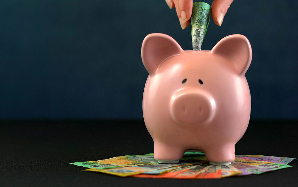 Tax cuts become law - piggy bank